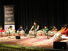 The first group performing with Guru