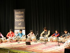 The second group performs with their Guru